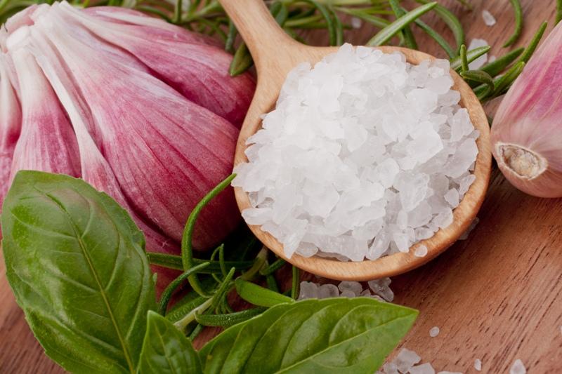 Fresh herbs and salt spoon